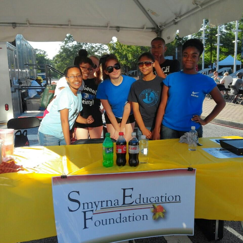 Campbell High School IB students volunteer at the SEF drink sales booth at Taste of Smyrna each year.